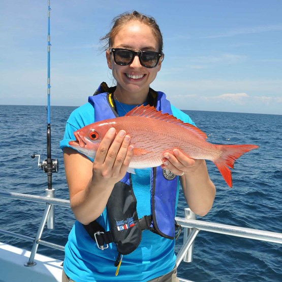 Photo of angler with vermilion snapper