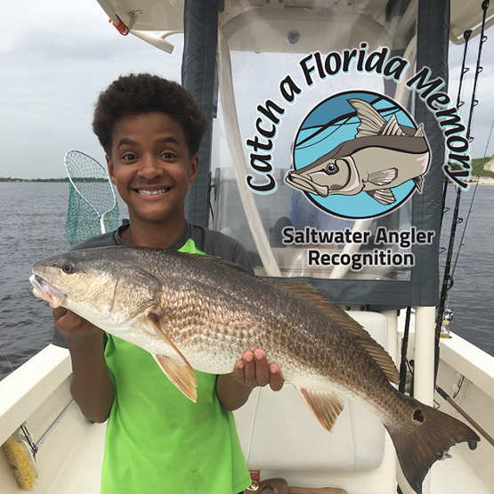 Photo of a boy holding a red drum