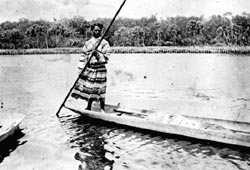 Seminole Indian in traditional boat